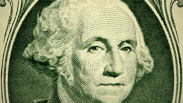 dolly shot showing extreme detail of george washington's engraving on the $1 dollar bill - american one dollar bill stock videos & royalty-free footage