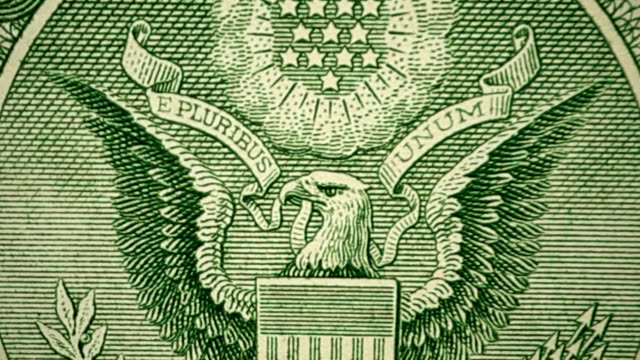 dolly shot showing extreme detail of the eagle emblem, seal of the united states of america engraving on $1 dollar bill - dollar symbol stock videos & royalty-free footage