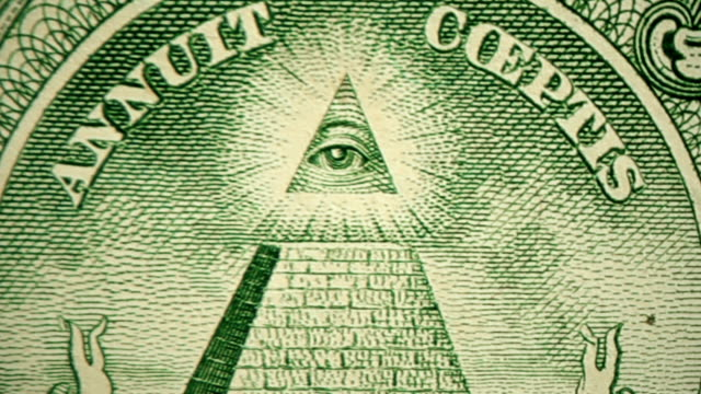 dolly shot showing extreme detail of the pyramid engraving on $1 dollar bill - american one dollar bill stock videos & royalty-free footage