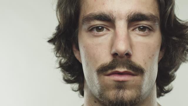 dolly shot spanish man staring at camera - beard stock videos & royalty-free footage