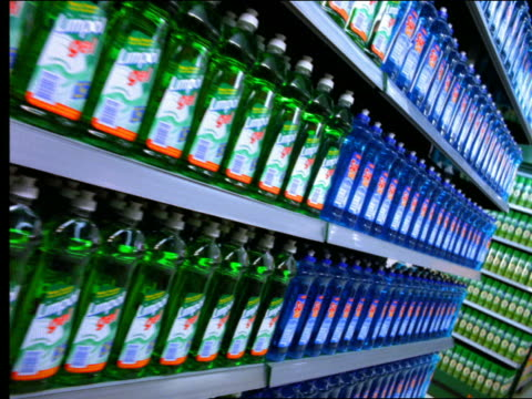 flash frames dolly shot supermarket aisle stocked with colorful cleaning supplies - repetition stock videos & royalty-free footage