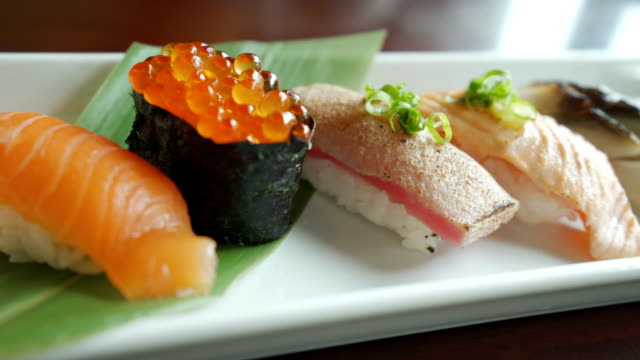 4k dolly shot  sushi in a row close up - sushi video stock e b–roll