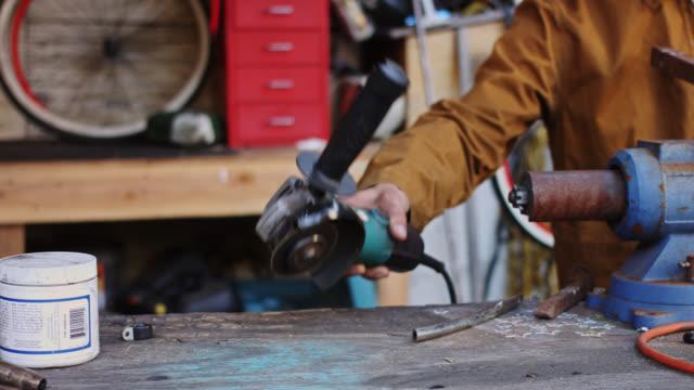 dolly shot through metalwork shop - metalwork stock videos & royalty-free footage
