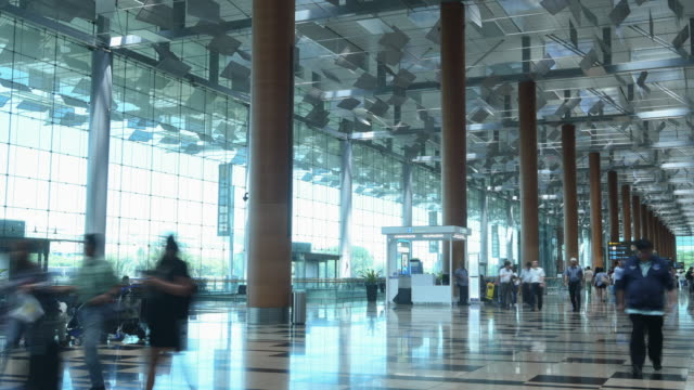 dolly shot time lapse departure terminal airport - airline check in attendant stock videos and b-roll footage