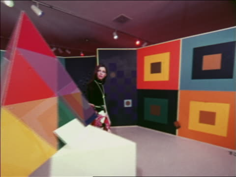 1970 dolly shot two fashion models in skirts looking at art exhibits in museum / atlanta / travelogue - skirt stock videos & royalty-free footage