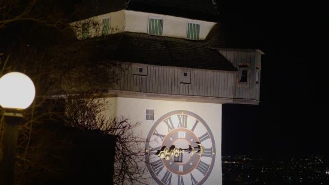 dolly shot: uhrturm, graz, austria, at night - clock tower stock videos & royalty-free footage