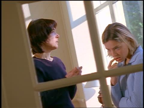 dolly shot upset mother having a serious talk with blonde teen daughter - skälla ut bildbanksvideor och videomaterial från bakom kulisserna