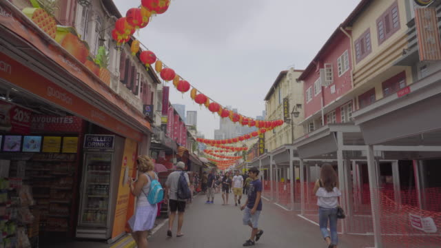 Dolly Shot View of walking street at Chinatown in Singapore.