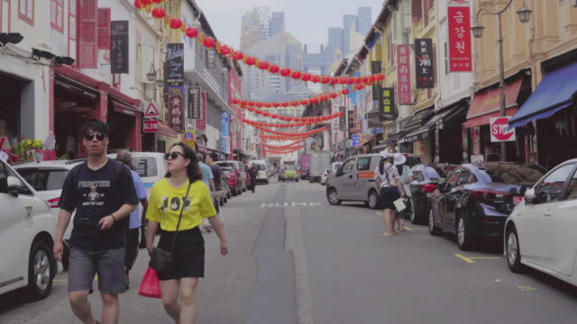 dolly shot view of walking street at chinatown in singapore. - southeast asia stock videos & royalty-free footage