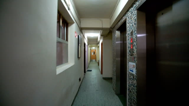 dolly shot, walking inside of apartments in hong kong. - bad condition stock videos & royalty-free footage
