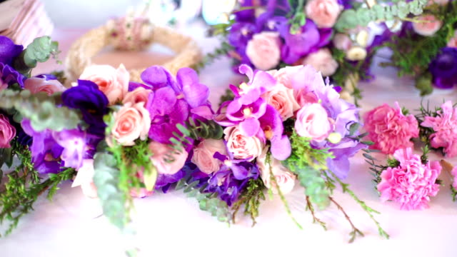 dolly shot : wedding decoration with mix of flower bouquet for the wedding on the table. - arranging stock videos & royalty-free footage
