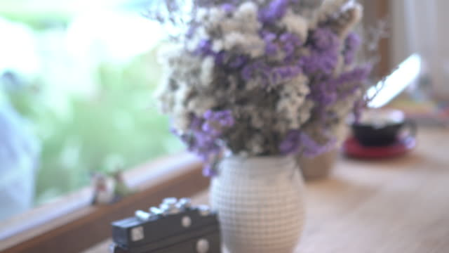 dolly shot windows light vase and coffee cup in bar counter - shade stock videos & royalty-free footage