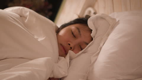dolly shot woman pull blanket and get sleep - pajamas stock videos & royalty-free footage