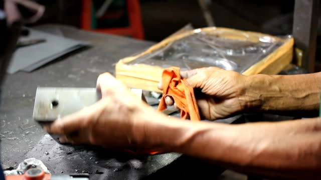 dolly shot: worker polishing metal. - bugtiger stock videos and b-roll footage