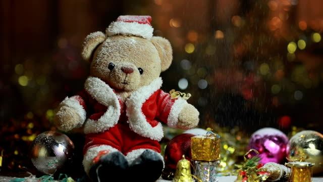 dolly shot:bear wearing christmas santa claus costume - plant bulb stock videos & royalty-free footage