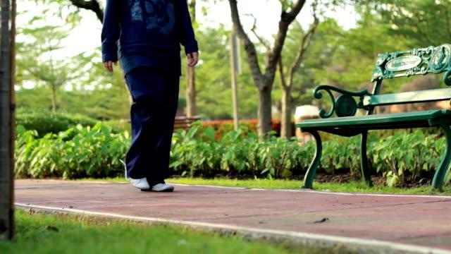 Dolly Shot:Girl walk in park