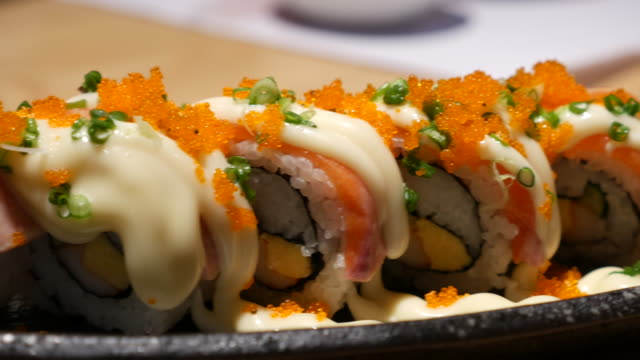 dolly shot:japanese sushi cuisine with fresh raw fish - wasabi stock videos and b-roll footage