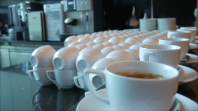 dolly shot:serving coffee and tea at bar - milk tea stock videos & royalty-free footage