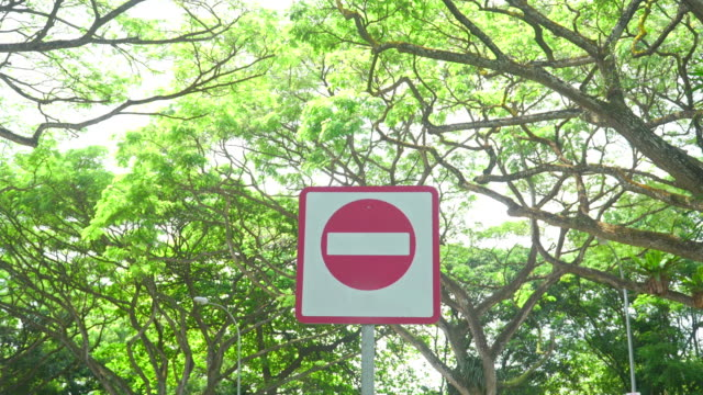 dolly: stop sign under park in Singapore