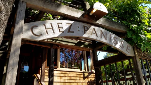dolly style shot from sign through entry arch to front staircase at chez panisse, the flagship restaurant of america restaurateur alice waters, who... - farm to table stock videos & royalty-free footage