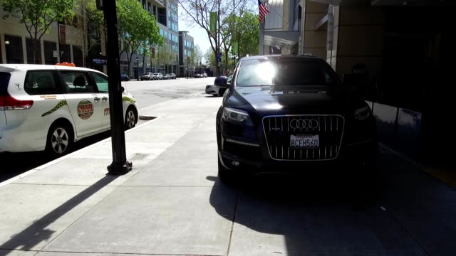 Dolly style stabilized camera shot traveling through downtown of the Silicon Valley town of San Jose California April 13 2019