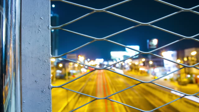 dolly : traffic city light behind steel fence - chainlink fence stock videos and b-roll footage