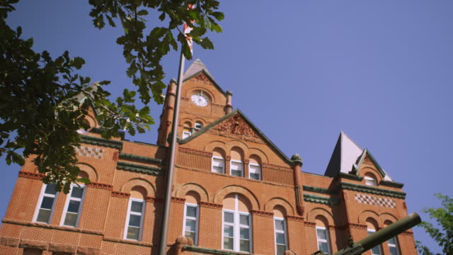dolly upward view of the cass county courthouse. - courthouse stock videos & royalty-free footage