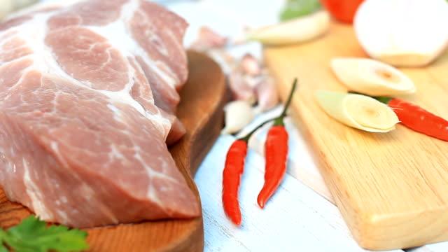 HD dolly:fresh pork chop on wood board with Condiment.