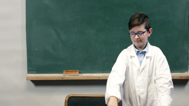 DOLLY:Happy child infront of blackboard
