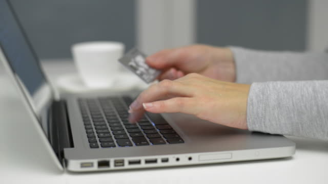 dolly,l to r female using laptop computer and credit card. - online shopping stock videos & royalty-free footage