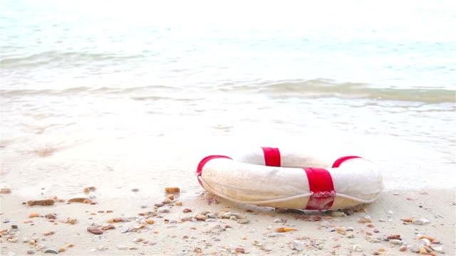 HD Dolly:Lifebuoy on the beach.