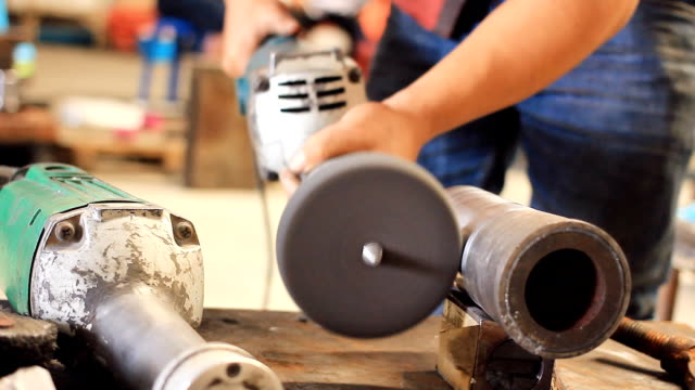 HD Dolly:Man working with an angle grinder