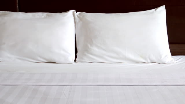 hd dolly:pillows placed on the bed. - bedclothes stock videos & royalty-free footage
