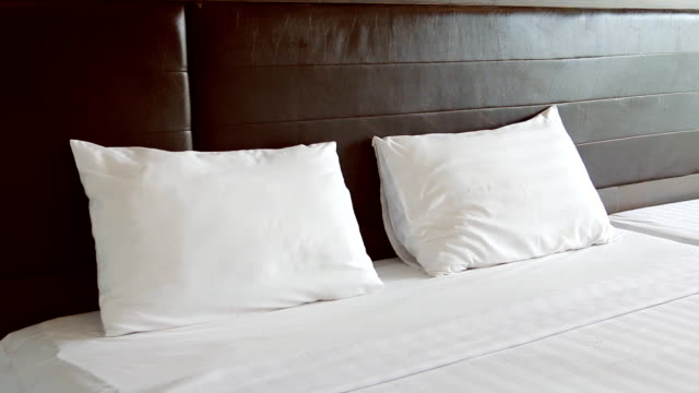 hd dolly:pillows placed on the bed. - double bed stock videos & royalty-free footage
