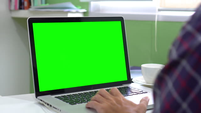 dolly:using computer laptop with green screen - over the shoulder view stock videos & royalty-free footage