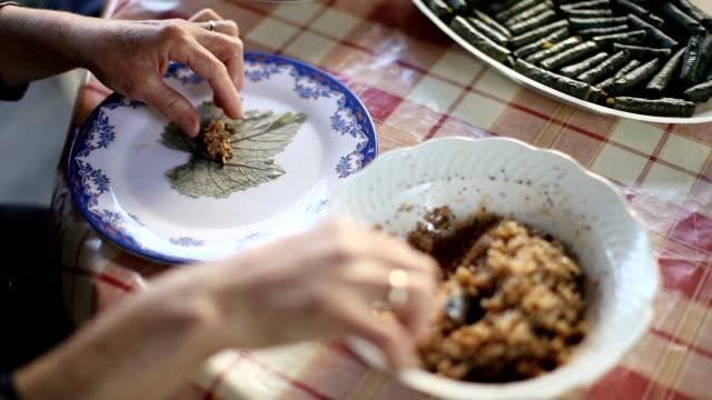 dolma - sarma. making of stuffed grape leaves - grape leaf stock videos & royalty-free footage