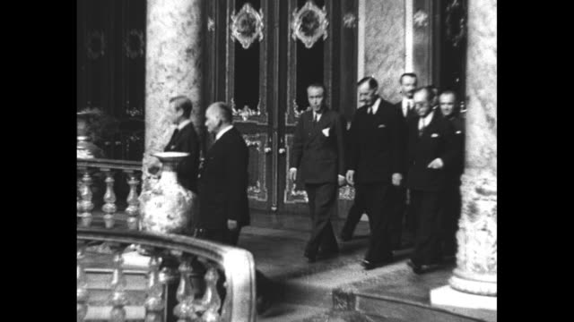dolmabahce palace in istanbul / montage turkish president mustafa kemal ataturk walks with king edward viii inside the palace and on its grounds - palace video stock e b–roll