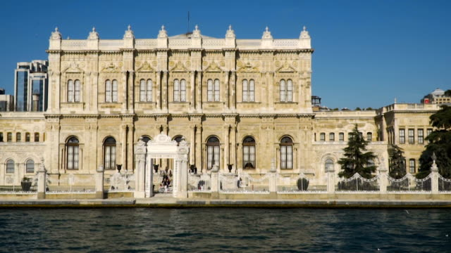 dolmabahce palace shot from sea - palace video stock e b–roll
