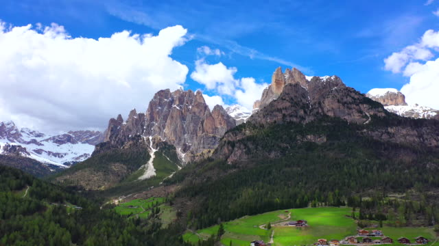 dolomites and village spring scenery / italy - 山岳地帯点の映像素材/bロール
