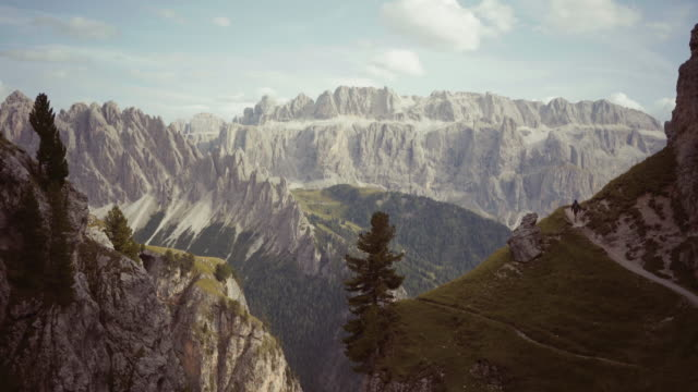 dolomites scenics view: man hiking - recreational horse riding stock videos & royalty-free footage