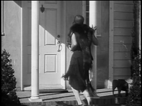 dolores del rio walking up to house + waving to camera / newsreel - 1928 stock videos & royalty-free footage