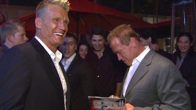 dolph lundgren, arnold schwarzenegger at arnold schwarzenegger celebrates the launch of his autobiography, total recall with a party at s mixology101... - autobiography stock videos & royalty-free footage