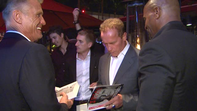 dolph lundgren, arnold schwarzenegger, terry crews at arnold schwarzenegger celebrates the launch of his autobiography, total recall with a party at... - autobiography stock videos & royalty-free footage