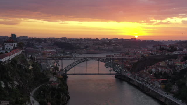 dom luis bridge downtown district sunset scenery / porto, portugal - porto district portugal stock videos & royalty-free footage