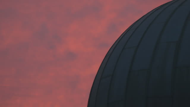a dome of an observatory in pink evening light - observatory stock videos and b-roll footage