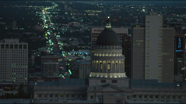 WS HA Dome of Capitol Building with traffic behind, night / Salt Lake City, Utah, USA