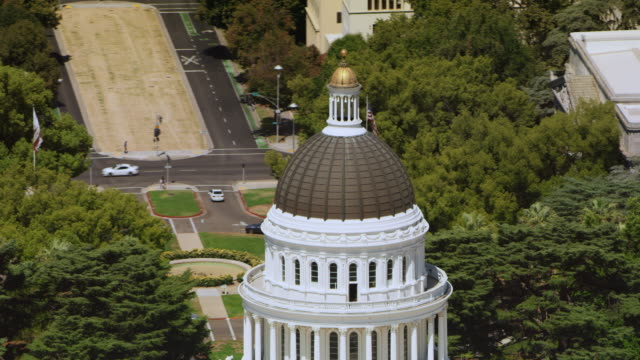aerial dome of the california state capitol in sacramento, ca - politics stock videos & royalty-free footage