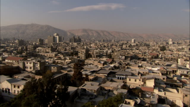 Domed mosques and modern skyscrapers makeup the city of Damascus. Available in HD.