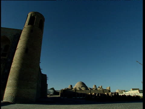 domed rooftops and towers of bukhara uzbekistan - bukhara stock videos & royalty-free footage