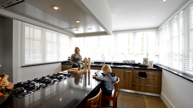 domestic scene in beautiful kitchen in luxury home with cooking island - new stock videos & royalty-free footage